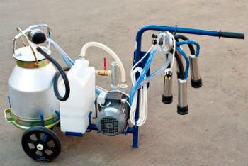 Доильный аппарат с подключенным вакуумным насосом